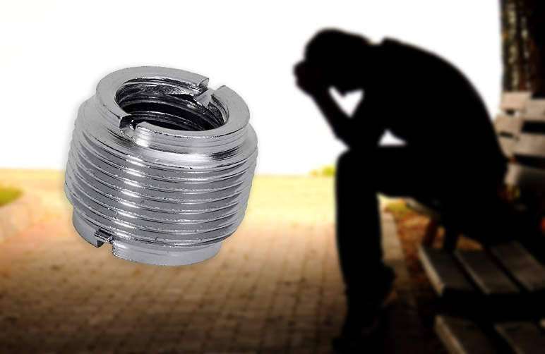 Depressed man and a giant thread adaptor