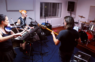 Band practising in the studio live room.
