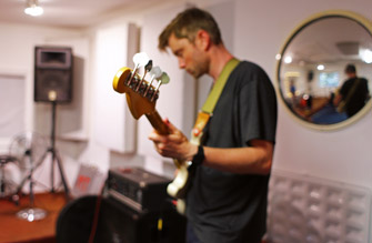 Bass player rehearses in the live room