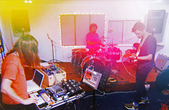 Band rehearses in the live room