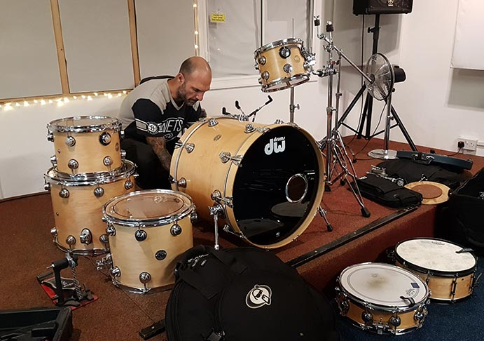 Drum kit being set up in live room